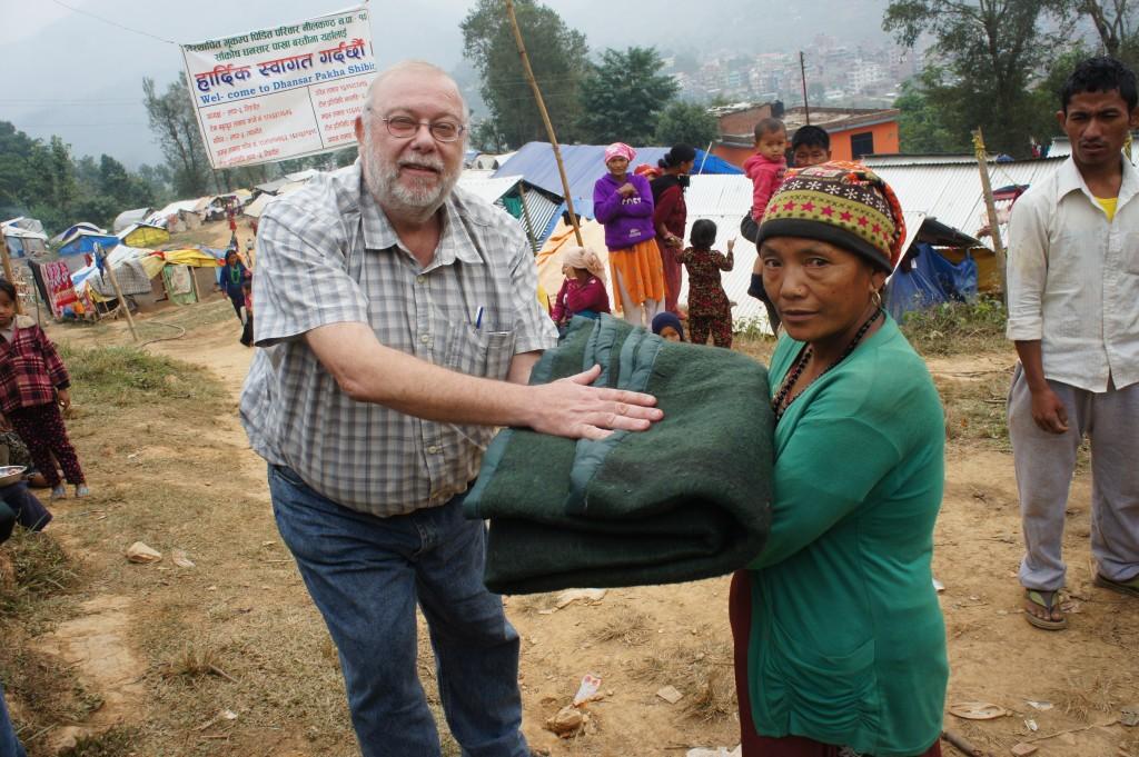 Jan Beaderstadt giving blankets in Nepal